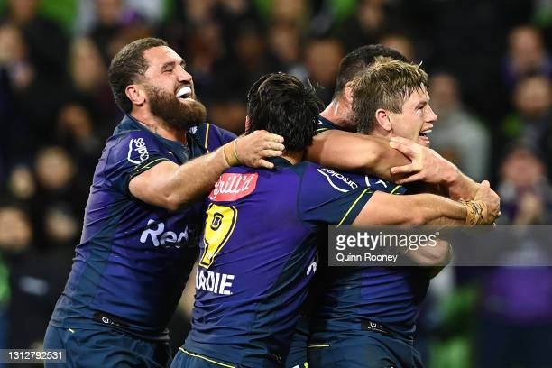 Harry Grant of the Storm celebrates with team mates after scoring a try during the round six NRL match between the Melbourne Storm and the Sydney...