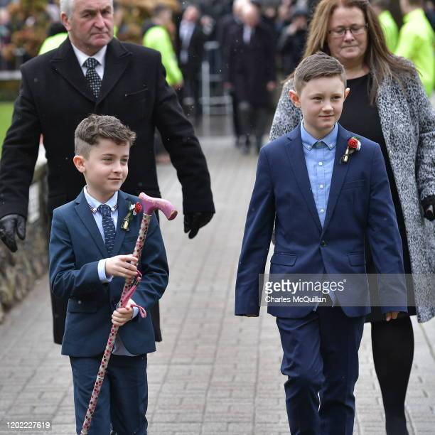Harry Gregg's grandson carries his grandfather's walking cane during the funeral for former Manchester United and Northern Ireland goalkeeper Harry...