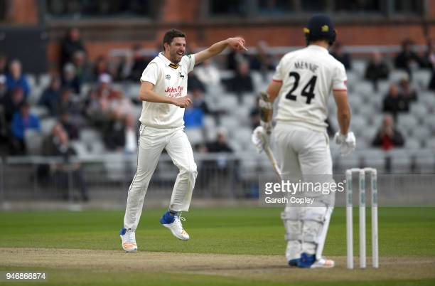 Harry Gurney of Nottinghamshire celebrates taking his sixth wicket after dismissing Joe Mennie of Lancashire during the four day of Specsavers County...