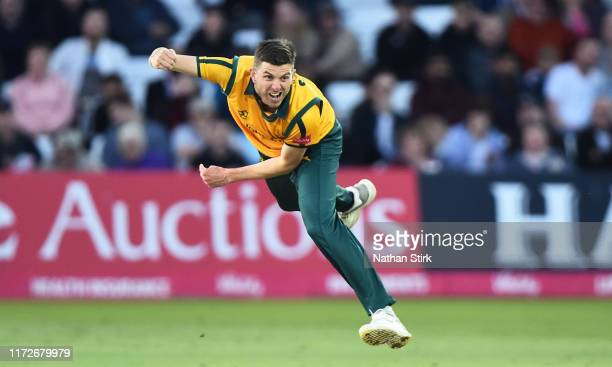 Harry Gurney of Notts Outlaws runs into bowl during the Vitality T20 Blast match between Notts Outlaws and Middlesex at Trent Bridge on September 05,...