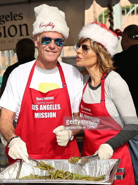 Harry Hamlin and Lisa Rinna are seen at the annual Los Angeles Mission Christmas Dinner on December 24 2015 in Los Angeles California