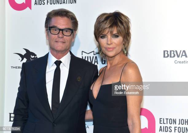 Harry Hamlin and Lisa Rinna attend the 26th annual Elton John AIDS Foundation's Academy Awards Viewing Party at The City of West Hollywood Park on...