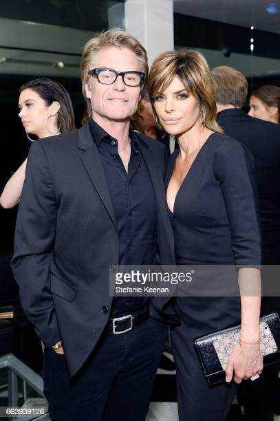 Harry Hamlin and Lisa Rinna attend The Daily Front Row and REVOLVE FLA after party at Mr Chow hosted by Mert Alas on April 2 2017 in Los Angeles...