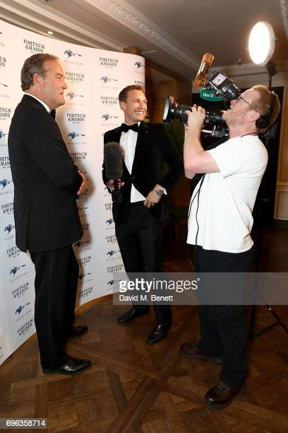 Harry Herbert and Oli Bell attends the Highclere Thoroughbred Racing Royal Ascot Dinner at Fortnum Mason on June 15 2017 in London England
