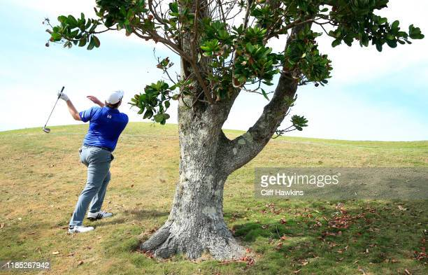 Harry Higgs of the United States plays his fourth shot on the seventh hole during the final round of the Bermuda Championship at Port Royal Golf...