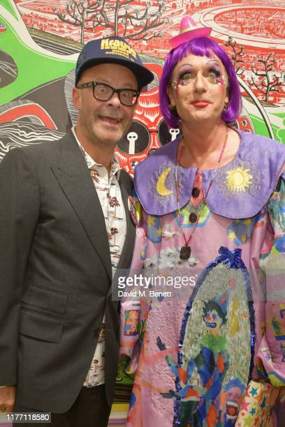 Harry Hill and Greyson Perry attend a private view of Grayson Perry Super Rich Interior Decoration at Victoria Miro Gallery on September 25 2019 in...
