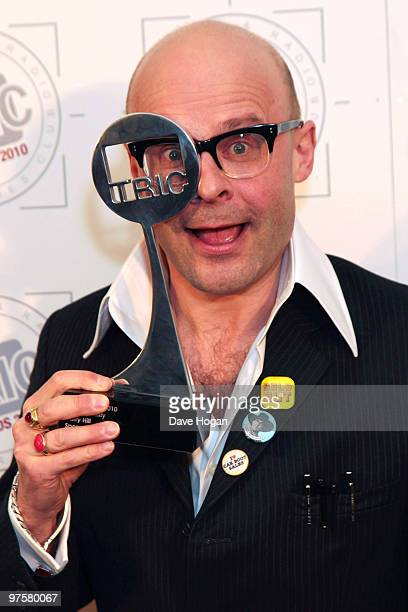 Harry Hill poses with his TV personality award in the press room at the TRIC Awards 2010 held at The Grosvenor House Hotel on March 9 2010 in London...