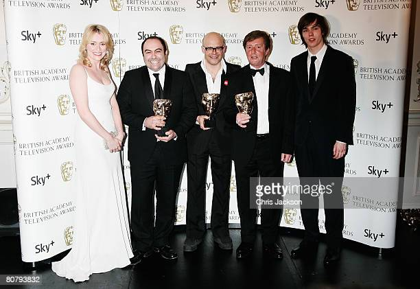 Harry Hill poses with the award for Best Entertainment Programme with Keeley Hawes Spencer Millman Peter Orton and Nicholas Hoult at the British...