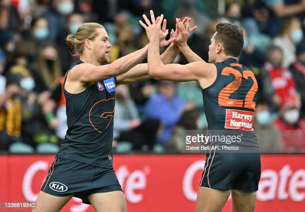 Harry Himmelberg of the Giants is congratulated by Josh Kelly after kicking a goal during the AFL Second Elimination Final match between the Sydney...