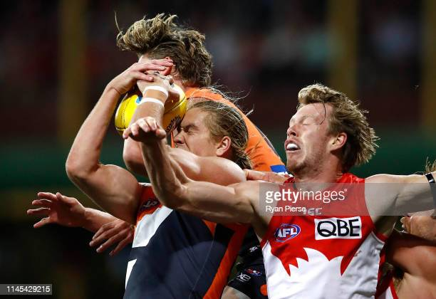 Harry Himmelberg of the Giants marks over Nick Blakey of the Swans during the round 6 AFL match between the Sydney Swans and GWS Giants at Sydney...