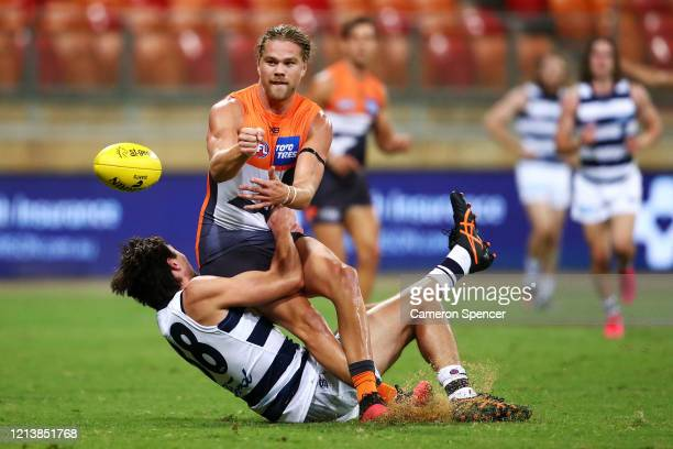 Harry Himmelberg of the Giants offloads the ball during the round 1 AFL match between the Greater Western Sydney Giants and the Geelong Cats at...