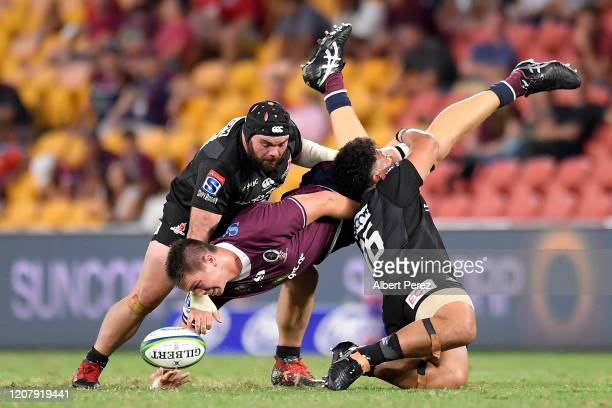 Harry Hockings of the Reds is tackled during the round four Super Rugby match between the Reds and the Sunwolves at Suncorp Stadium on February 22,...