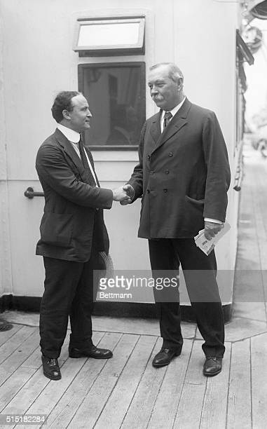 Harry Houdini and Sir Arthur Conan Doyle shake hands as Doyle prepares to depart for the UK on the SS Adriatic after his visit to the United States