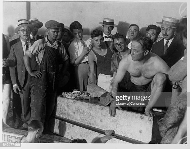 Harry Houdini emerges from the coffin in which he was sealed for 90 minutes and immersed in the Hotel Sheridan's swimming pool Houdini would be dead...