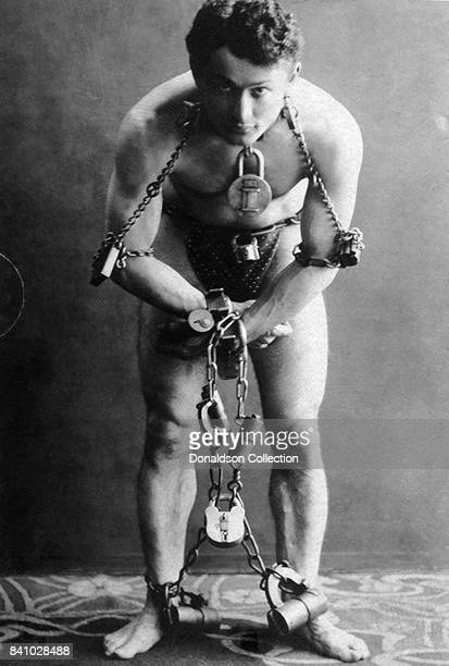 Harry Houdini fulllength portrait standing facing front in chains in circa 1899