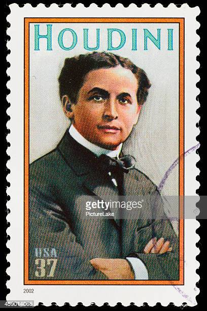 usa harry houdini postage stamp - harry houdini stock photos and pictures