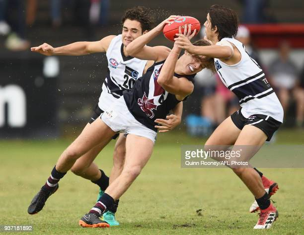 Harry Houlahan of the Dragons is tackled during the round one TAC Cup match between Northern Knights and Sandringham at Frankston Oval on March 24...