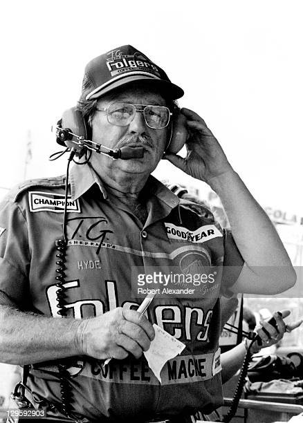 Harry Hyde crew chief for NASCAR driver Tim Richmond talks with his driver during the 1986 Firecracker 400 at the Daytona International Speedway on...