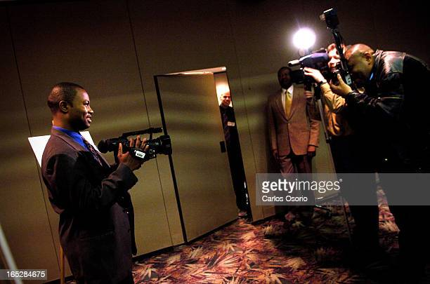 Harry Jerome Toronto Ontario Harry Jerome Award winner for Arts and Entertainment Louis Mercier videotapes members of the media after it was...