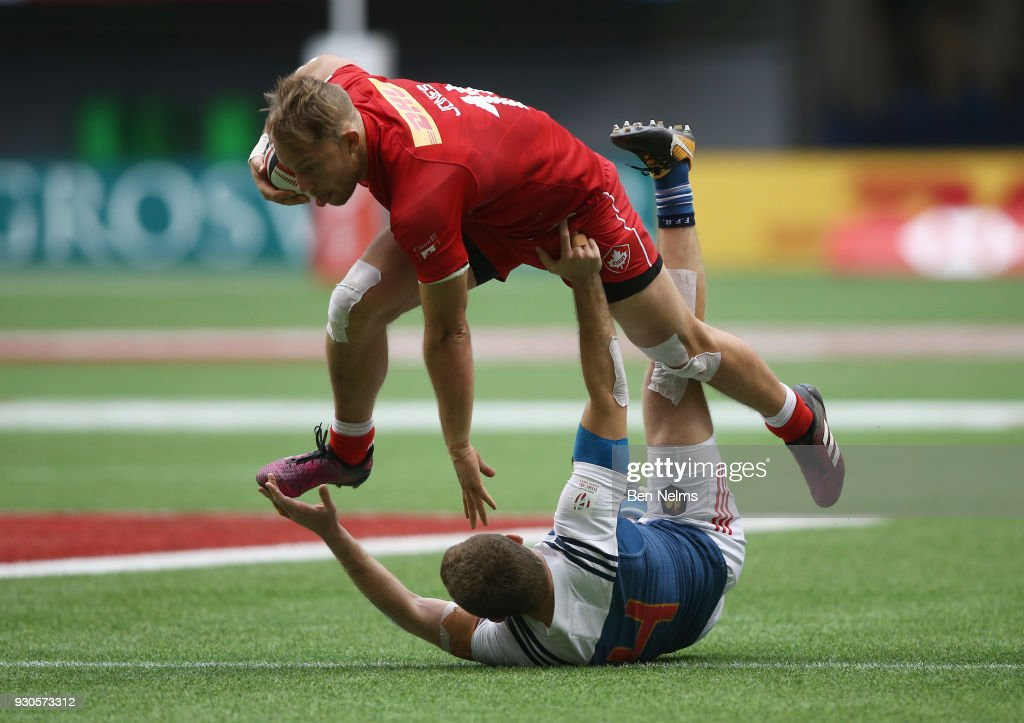 Harry Jones of Canada runs the ball against Thibauld Mazzoleni of France during the Canada Sevens, the Sixth round of the HSBC Sevens World Series at the BC Place stadium Centre on March 11, 2018 in Vancouver, British Columbia, Canada.