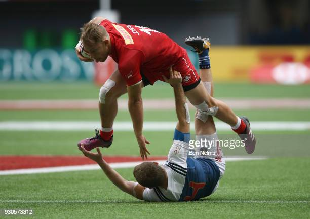 Harry Jones of Canada runs the ball against Thibauld Mazzoleni of France during the Canada Sevens the Sixth round of the HSBC Sevens World Series at...