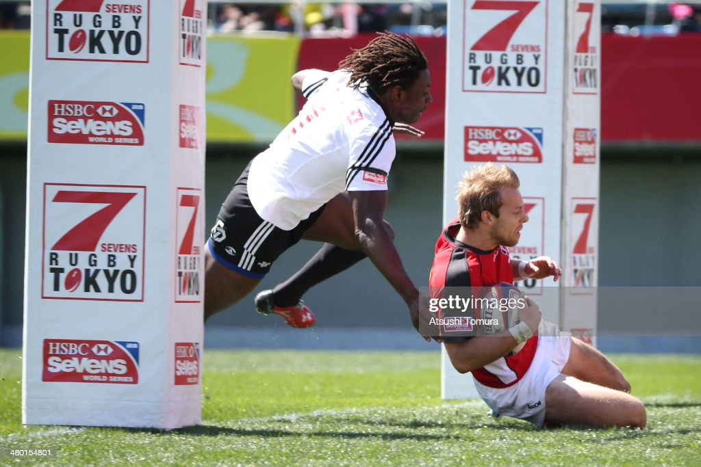 Harry Jones #11 of Canada scores a try against Portugal during the Tokyo Sevens, the six round of the HSBC Sevens World Series at the Prince Chichibu Memorial Ground on March 22, 2014 in Tokyo, Japan.