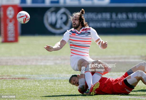 Harry Jones of Canada tackles Dan Bibby of England as he passes during the USA Sevens Rugby tournament at Sam Boyd Stadium on March 5 2017 in Las...