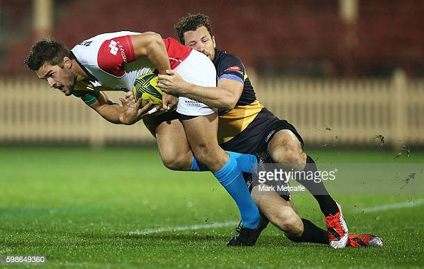 Harry Jones of the Rays is tackled during the round two NRC match between the Sydney Rays and the Perth Spirit at North Sydney Oval on September 2...
