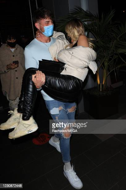 Harry Jowsey and Tana Mongeau seen leaving Boa Steakhouse on January 29, 2021 in Los Angeles, California.