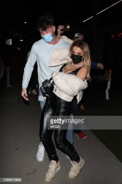 Harry Jowsey carries Tana Mongeau after dinner on January 29, 2021 in Los Angeles, California.