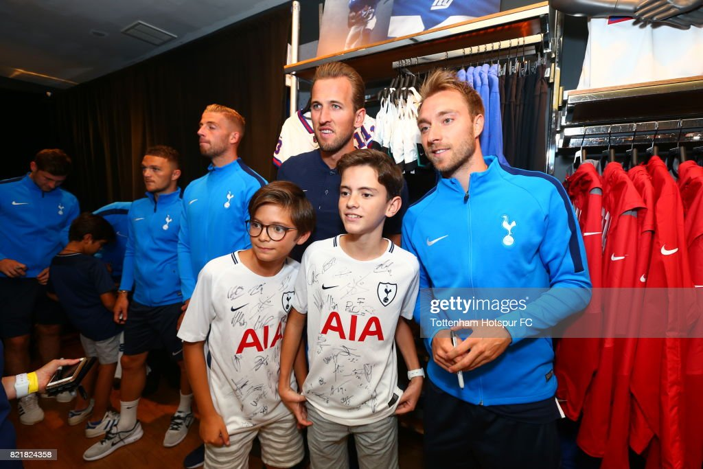 Harry Kane (L) and Christian Eriksen of Tottenham Hotspur FC pose with fans on a visit to Nike Town on Tottenham Hotspur Pre-Season Tour to the US on July 23, 2017 in New York, New York.