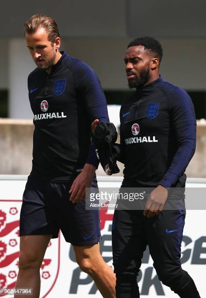 Harry Kane and Danny Rose of England walk out prior to during the England training session at St Georges Park on June 6 2018 in BurtonuponTrent...