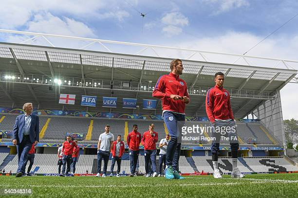 Harry Kane and Delli Alli look on during the England team walk around at the Stade Bollaert-Delelis ahead of their EURO 2016 match against Wales on...