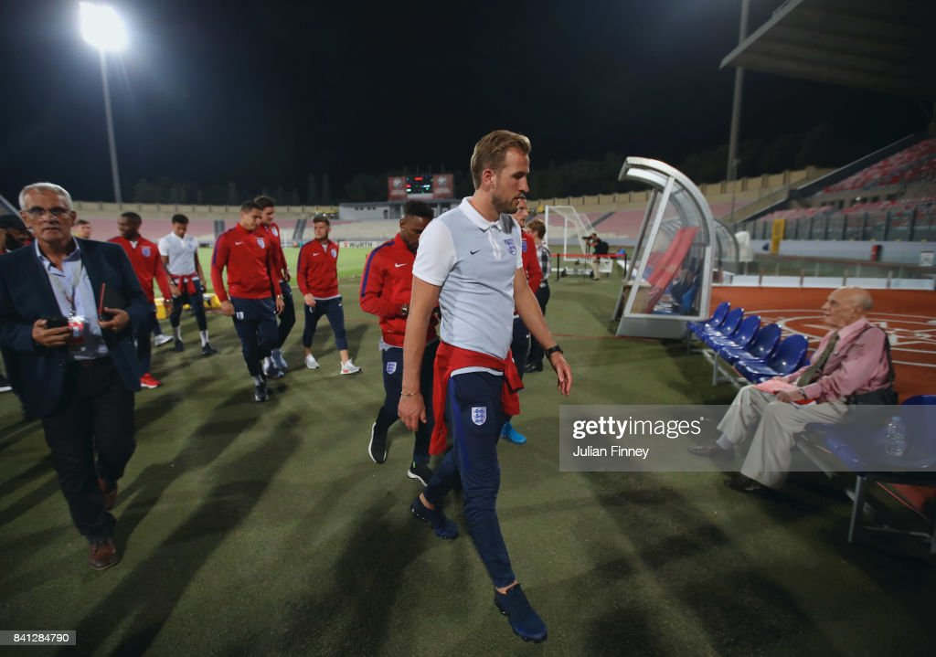 Harry Kane (front) and England team mates inspect the pitch on the eve of the World Cup qualifying match against Malta at Ta'Qali National Stadium on August 31, 2017 in Valletta, Malta.