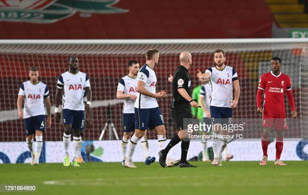 Harry Kane and Eric Dier of Tottenham Hotspur appeal to match referee Anthony Taylor after Liverpool's second goal during the Premier League match...