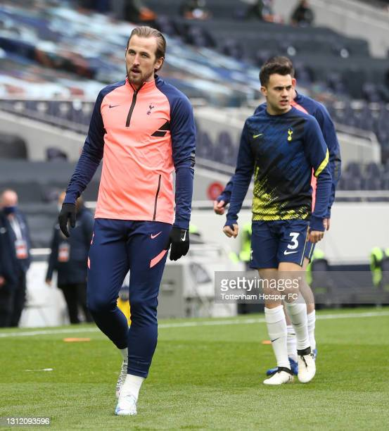 Harry Kane and Sergio Reguilon of Tottenham Hotspur warm up during the Premier League match between Tottenham Hotspur and Manchester United at...