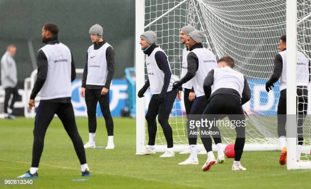 Harry Kane and team mates take part in a drill during an England training session at Spartak Zelenogorsk Stadium on July 6 2018 in Saint Petersburg...