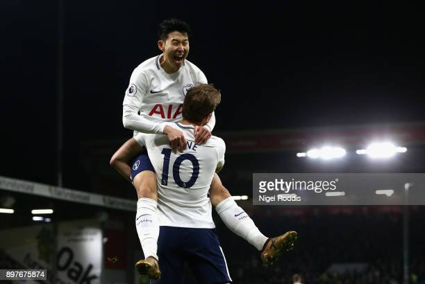 Harry Kane celebrates with HeungMin Son of Tottenham Hotspur after he scores his sides first goal during the Premier League match between Burnley and...