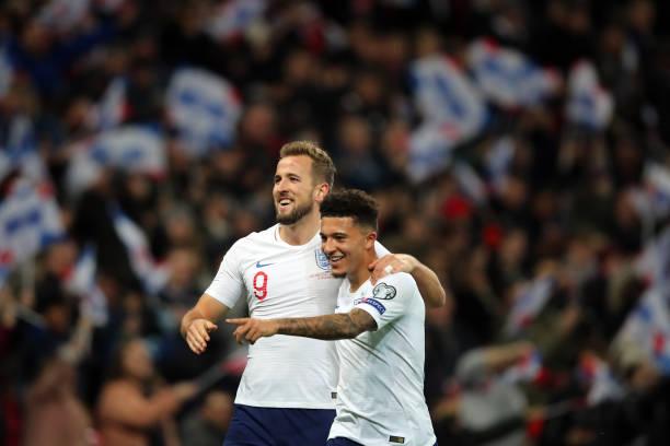 Harry Kane celebrates with Jadon Sancho of England during the UEFA Euro 2020 qualifier between England and Montenegro at Wembley Stadium on November...