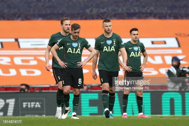 Harry Kane , Harry Winks and Eric Dier of Tottenham Hotspur reacts after conceding their side's first goal during the Carabao Cup Final between...