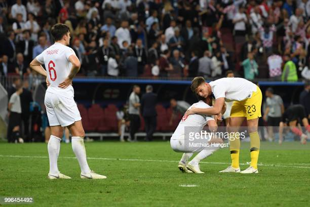 Harry Kane is consoled by Nick Pope as Harry Maguire looks on dejected following during the 2018 FIFA World Cup Russia Semi Final match between...