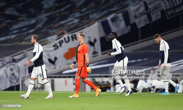 Harry Kane Joe Hart Davinson Sanchez and Matt Doherty of Tottenham Hotspur walk out prior to the UEFA Europa League playoff match between Tottenham...