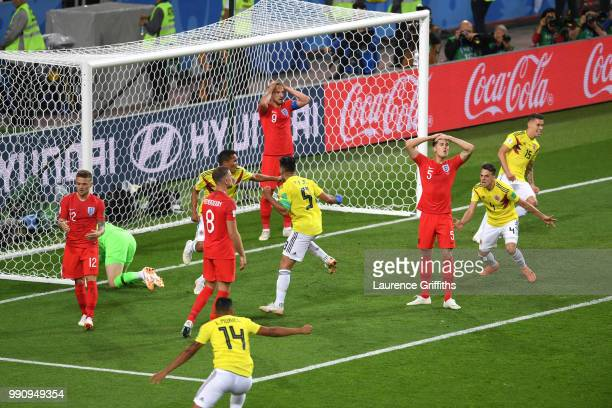 Harry Kane John Stones Jordan Henderson and Kieran Trippier of of England react after Colombia equalizing goal during the 2018 FIFA World Cup Russia...