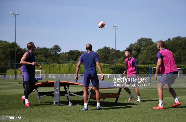 Harry Kane, Lucas Moura, Heung-Min Son and Eric Dier train during the Tottenham Hotspur training session at Tottenham Hotspur Training Centre on May...