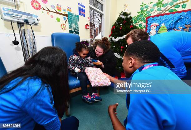 Harry Kane Maya Vio and Kyle WalkerPeters meet a young patient during a Tottenham Hotspur player visit at Whipps Cross Hospital on December 21 2017...