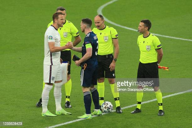 Harry Kane of England and Andrew Robertson of Scotland shake hands during the UEFA Euro 2020 Championship Group D match between England and Scotland...
