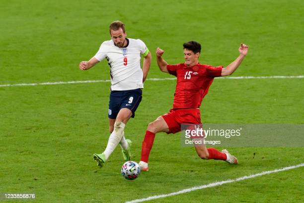 Harry Kane of England and Christian Noergaard of Denmark battle for the ball during the UEFA Euro 2020 Championship Semi-final match between England...