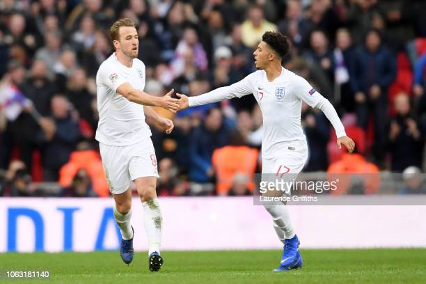 Harry Kane of England and Jadon Sancho of England celebrate after Jesse Lingard of England scores their team's first goal during the UEFA Nations...