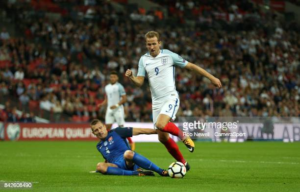 Harry Kane of England and Jan Durica of Slovakia during the FIFA 2018 World Cup Qualifier between England and Slovakia at Wembley Stadium on...