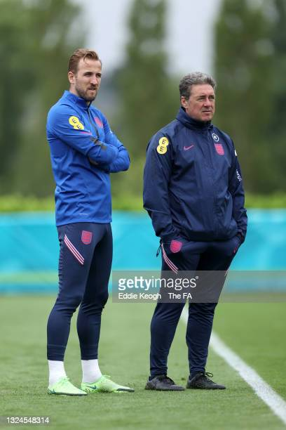 Harry Kane of England and John McDermott, Assistant Technical Director look on during a training session at Tottenham Hotspur Training Ground on June...